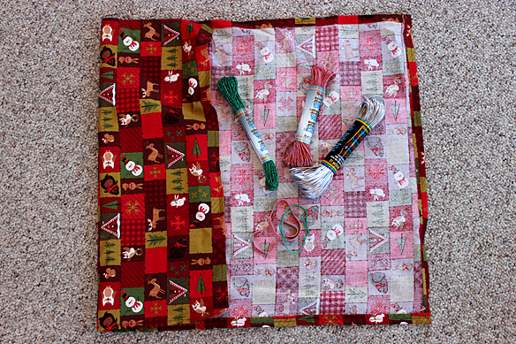 cloth wrap for presents,  colorful ribbon, and rubber bands to secure the wrap while tying with ribbon.