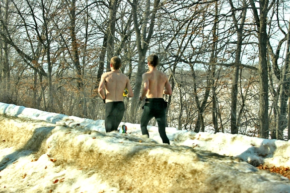 Torsos bared to the wind, young Minnesotans revel in the warmth of a 42 F day.