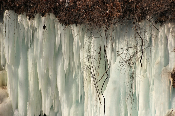 An ice curtain hung over the door to the cave behind the falls.