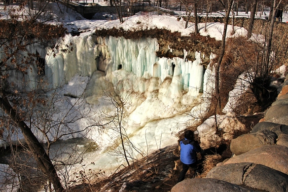 The falls were still well frozen, but slick with melt water running down columns of ice.  The ice had taken on a surprising number of hues from white to blue to yellow to amber colors.  The person in the photo isn't really on a trail, but I figured if she could walk down to the waterfall, so could I.