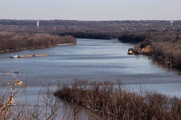 The high bluffs and wide expanse of the river make this SNA the perfect spot for watching bird migration.    Now that the river is ice-free, barge traffic resumes (the one on the left of the photo was moving sand upriver).