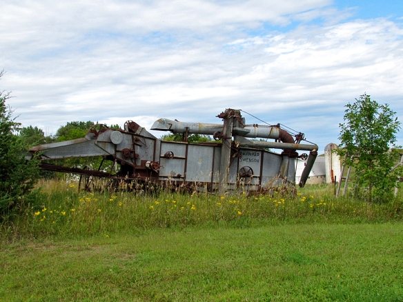 Farmers collect these old grain threshers for display as yard art today.