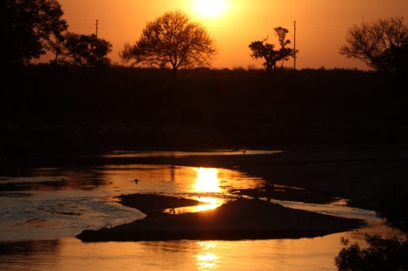 Sunset over the crocodile river in Kruger Park, S.A.