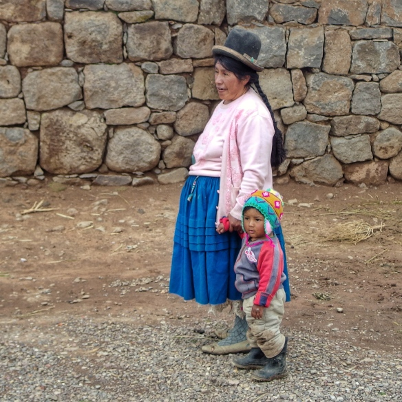 Andean lady and her son, near Puno, Peru